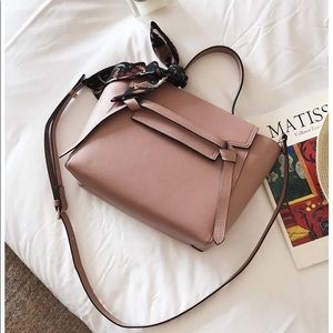 Women's cream leather handle on top crossbody bag